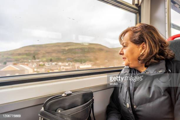 senior hispanic woman on train - horsedrawn stock pictures, royalty-free photos & images