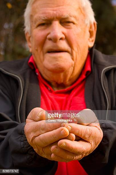 Senior holding cherry tomatoes