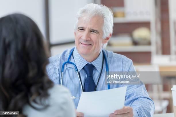 Senior hospital administrator interviews job candidate