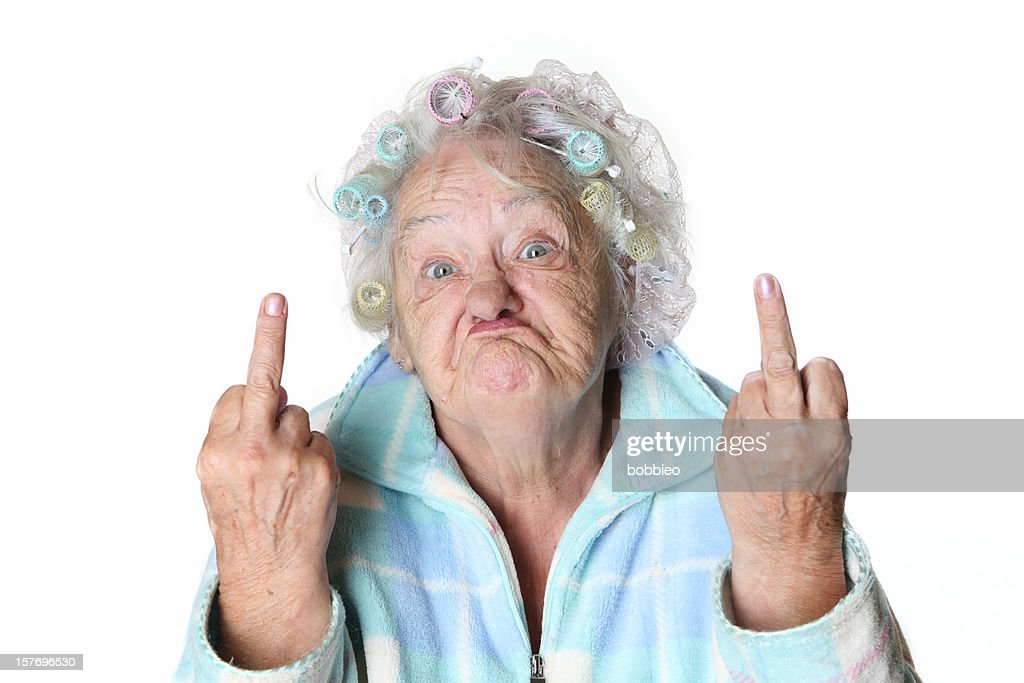 Senior Humor: cranky woman making faces and flipping the bird. : Stock Photo