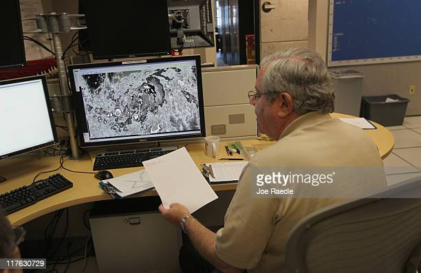 Senior hurricane forecaster Dr Richard Pasch charts the path of Tropical Storm Arlene at the National Hurricane Center on June 29 2011 in Miami...