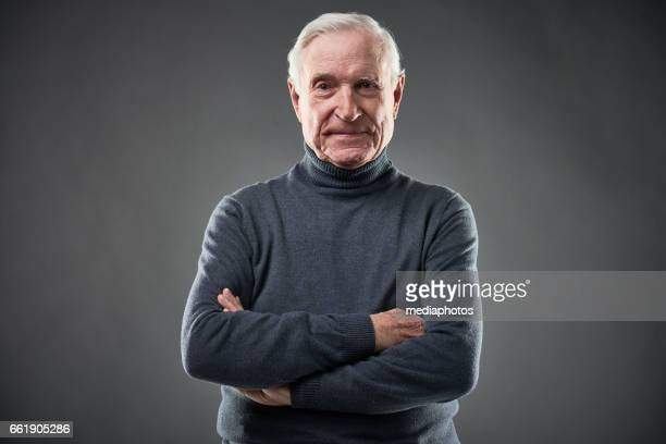 senior in polo-neck - turtleneck stock pictures, royalty-free photos & images