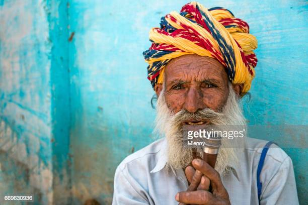 Senior Indian Man holding his Pipe Real People Portrait India