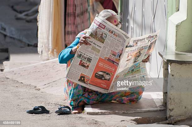 Senior Indian woman reading the newspaper