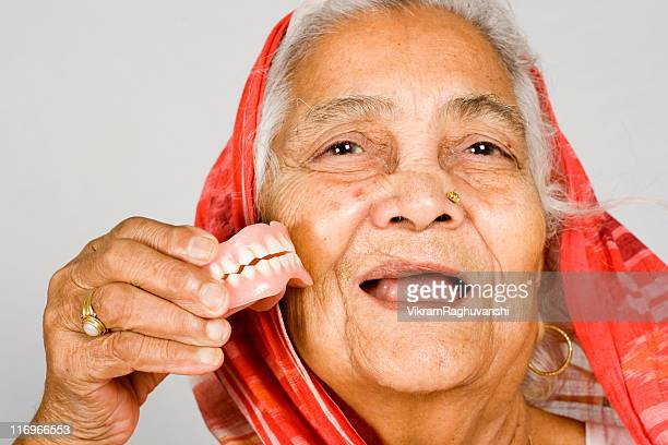 Senior Indian Woman showing her Denture Health Problems