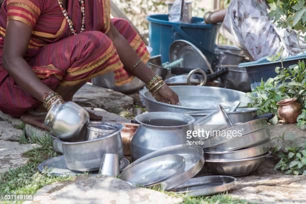 senior indian women washing dishes - マハラシュトラ州 ストックフォトと画像