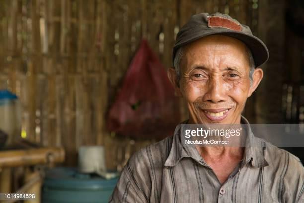 senior indonesian farmer smiling portrait in hut - indonesia foto e immagini stock