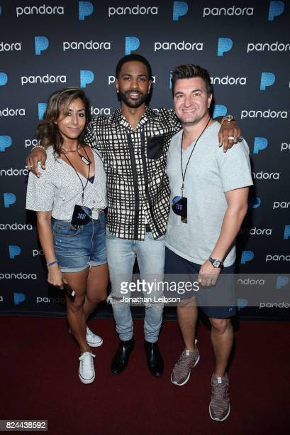 Senior Industry Relations Director at Pandora Gurj Bassi Big Sean and Vicepresident Jeff Zuchowski at Pandora Sounds Like You Summer at Los Angeles...