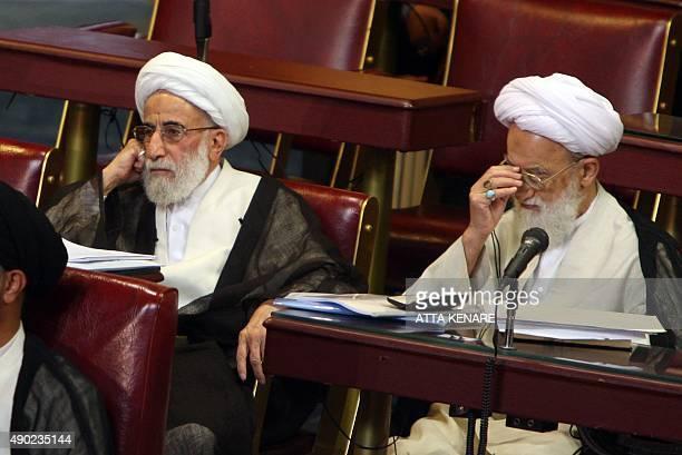 Senior Iranian clerics Ayatollah Ahmad Jannati and Mohammad ImamiKashani listen to the head of Iran's Assembly of Experts Akbar Hashemi Rafsanjani as...