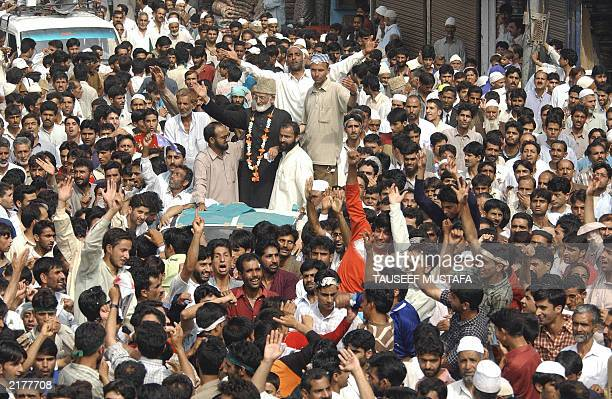 Senior Jamiat-Islami leader and Former chairman of All Parties Hurriyat Confrence Syed Ali Shah Geelani waves to supporters at a rally in Sopore some...