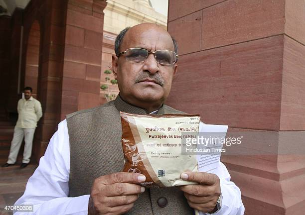 Senior Janata DalUnited leader KC Tyagi showing a packet of Putrajeevak Beej a medicinal product of Yoga guru Baba Ramdev that guarantees birth of a...