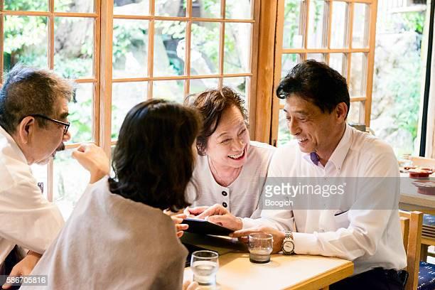 Senior Japanese Couples Looking at Menu in Kyoto Restaurant Japan
