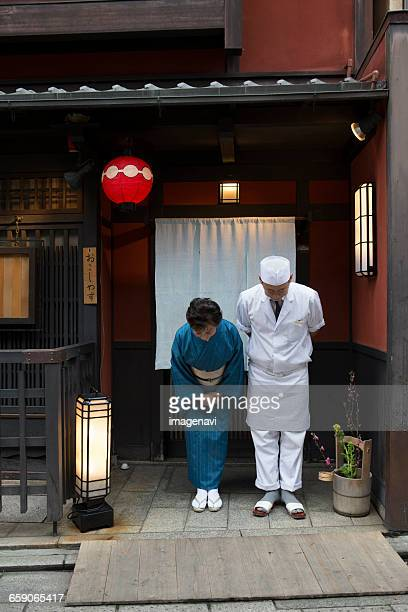 Senior Japanese hostess and cook bowing