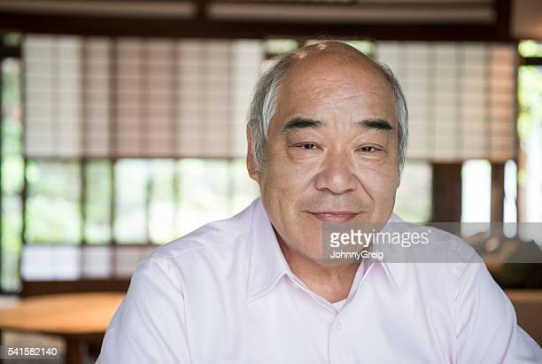 Senior Japanese man looking at camera, portrait