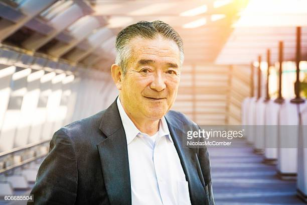 Senior Japanese man portrait at sunset urban setting