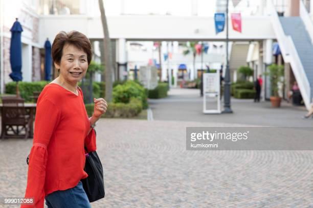 Senior Japanese woman at shopping mall