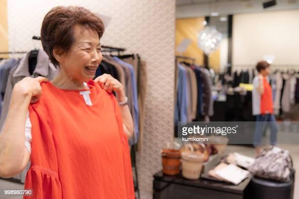 Senior Japanese woman shopping clothes