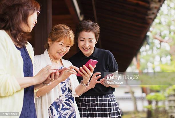 Senior Japanese Women Looking at Pictures on Phone