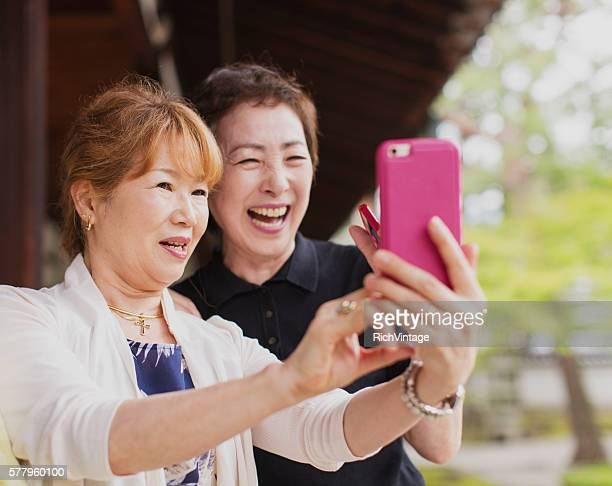 Senior Japanese Women Taking Pictures with Phone