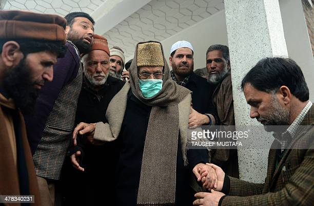 Senior Kashmiri seperatist leader Syed Ali Shah Geelani is escorted by officials as he leaves his residence in Srinagar on March 13 Geelani who is...