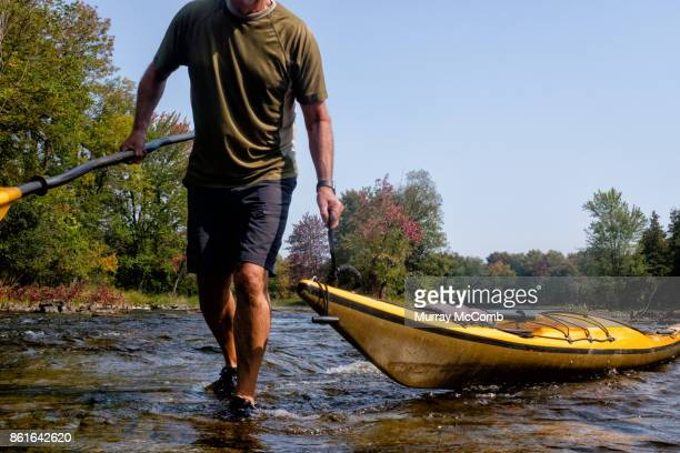senior kayaker going upstream the hard way - murray mccomb stock pictures, royalty-free photos & images