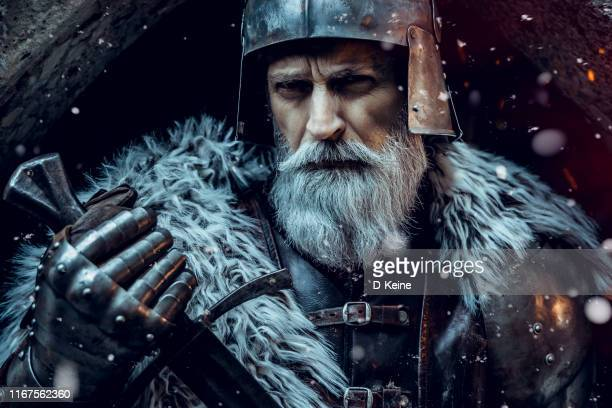 senior knight  wearing traditional clothes with sword - wizard stock pictures, royalty-free photos & images