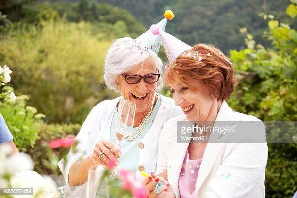 Senior ladies drinking champagne at birthday party