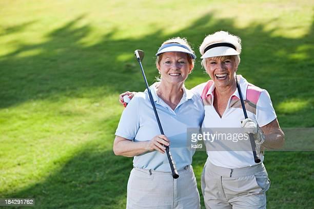 Senior ladies playing golf