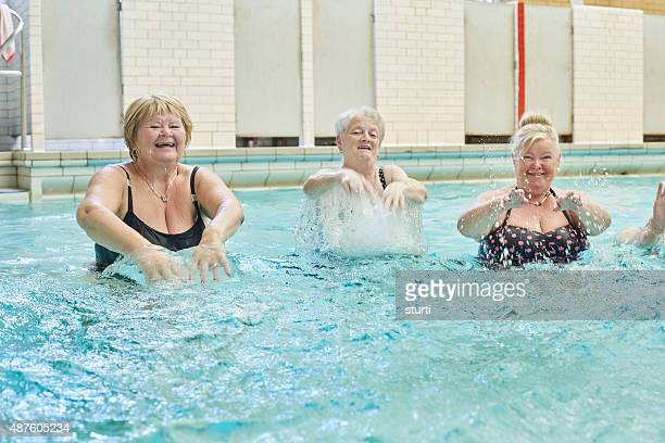 senior ladies splashing in pool