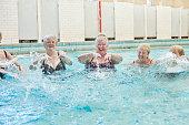 senior ladies splashing in pool