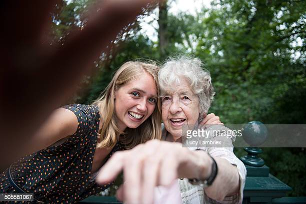 senior (98) lady and young woman making a selfie - candid stock pictures, royalty-free photos & images