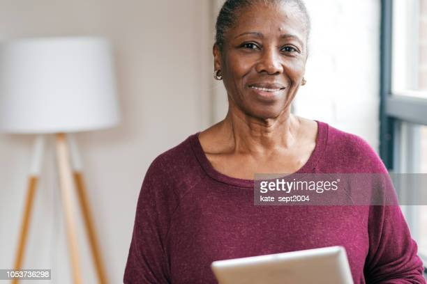 Senior lady at home working with documents