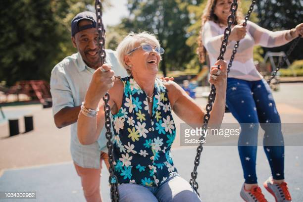 Senior Lady Being Pushed on the Swings