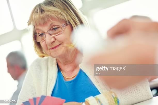 Senior lady enjoying a game of cards