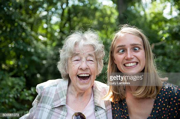 Senior (98) lady laughing at young woman squinting