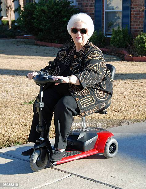 senior lady on a mobility scooter - mobility scooter stock photos and pictures