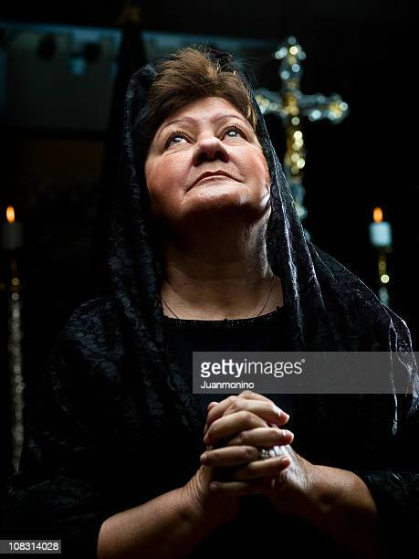 Senior Lady Praying at the Church