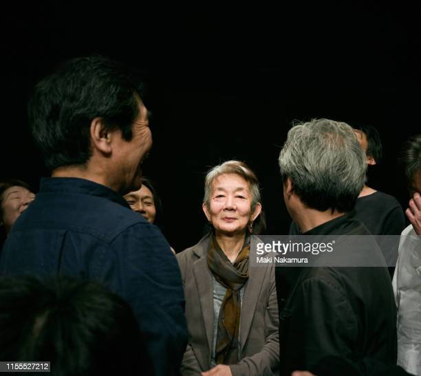 senior lady standing proudly among the people - 囲む ストックフォトと画像
