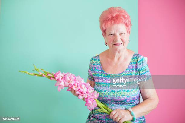 Senior lady with Gladiolus