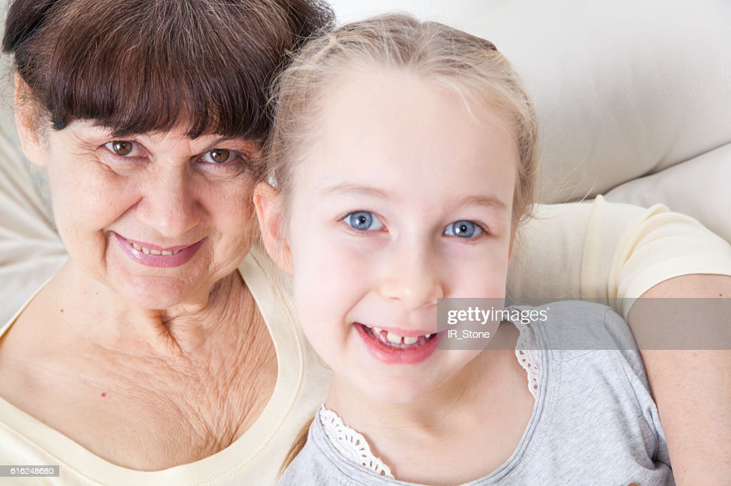 Senior lady with granddaughter portrait : Stock Photo