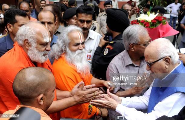 BJP senior leader LK Advani meets UP Chief Minister Yogi Adityanath along with Vedanti Jee Maharaj and main priest of Ayodhya Dharmdas at VVIP guest...