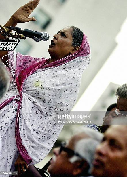Senior Leader of Bangladesh's Awami League Motia Chowdhury is watched by party general secretary Abdul Jalil as she addresses a antigovernment...