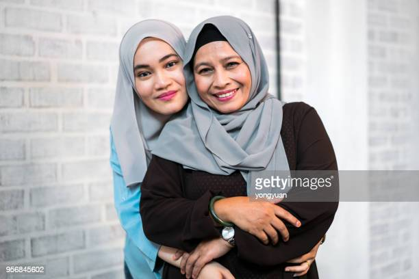 Senior Malaysian woman with her daughter