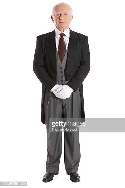 senior male butler, hands clasped, portrait - tail coat stock pictures, royalty-free photos & images