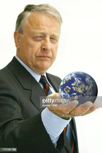 Senior Male Caucasian Businessman Holding World in Hand