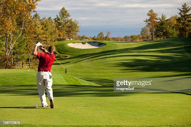 senior male caucasian golfer driving off the tee in fall - golf stock pictures, royalty-free photos & images