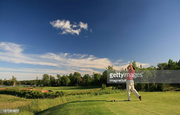 Senior Male Caucasian Golfer Hitting a Tee Shot