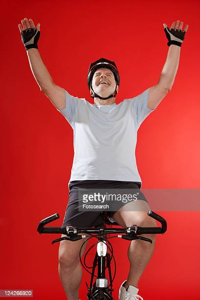 senior male cyclist celebrating - hands free cycling stock pictures, royalty-free photos & images