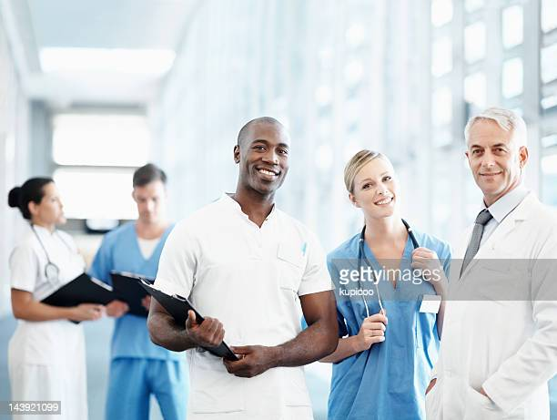 Senior male doctor and his medical team