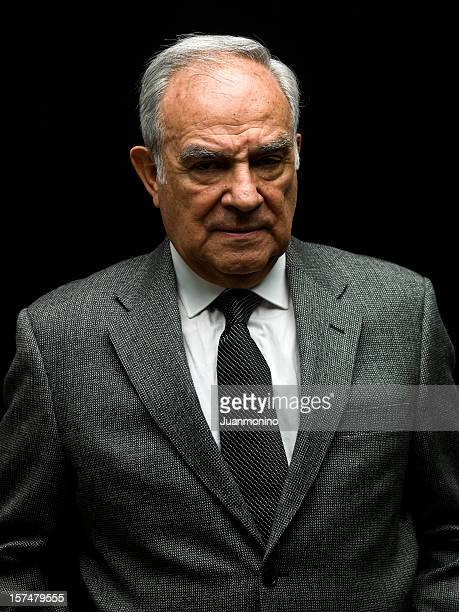 senior male dressed in a business suit. - evil stock pictures, royalty-free photos & images